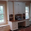 Built-in desk, bookcases, cabinet and window seats.