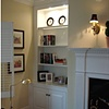Corner cabinet and mantel.