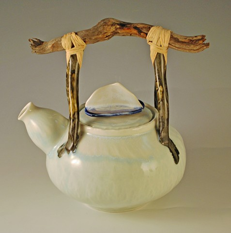 Porcelain teapot with Velella velella on the lid