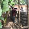 Passing bricks hand to hand