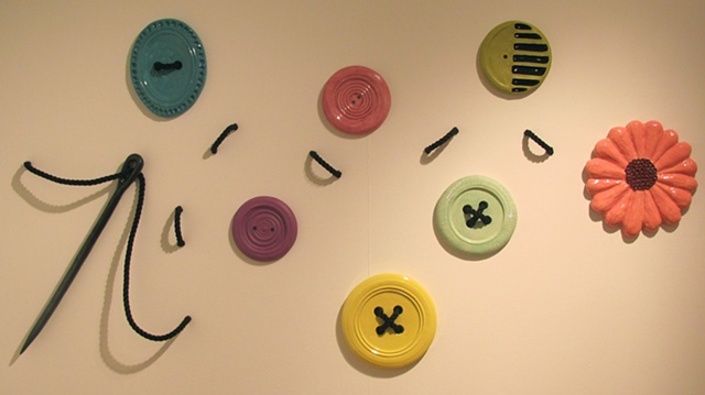 Wall hanging buttons