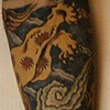 Left arm tattoo of Japanese Lion & Cloud