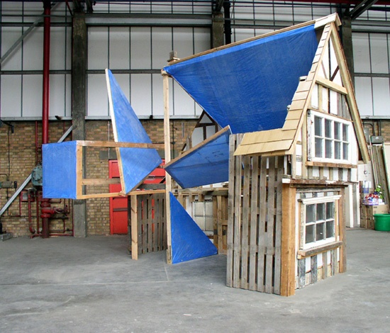 reduced scale mock tudor cottage made from the contents of skips