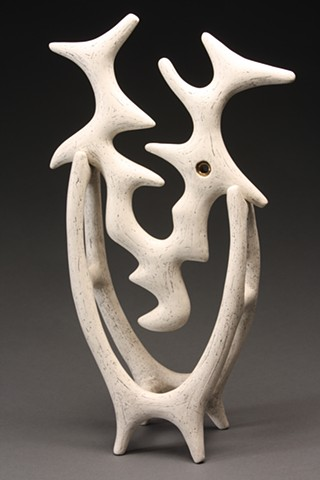 Abstract ritualistic sculpture made from white earthenware, gold luster and iron wash