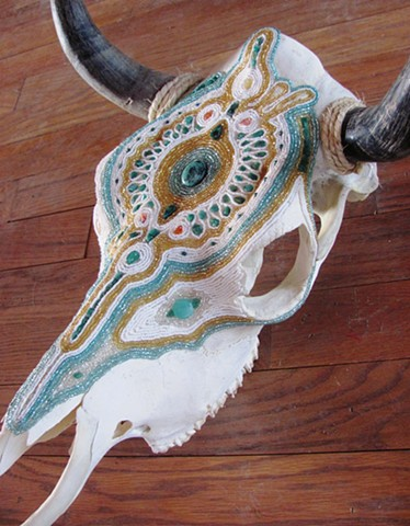 Intricately Beaded Steer Skull mosaic with turquoise, quartz crystals, and glass beads