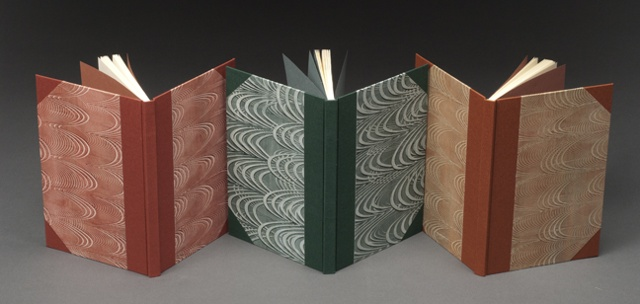 Three Half Cloth Flatback Case Bindings with Pastepaper