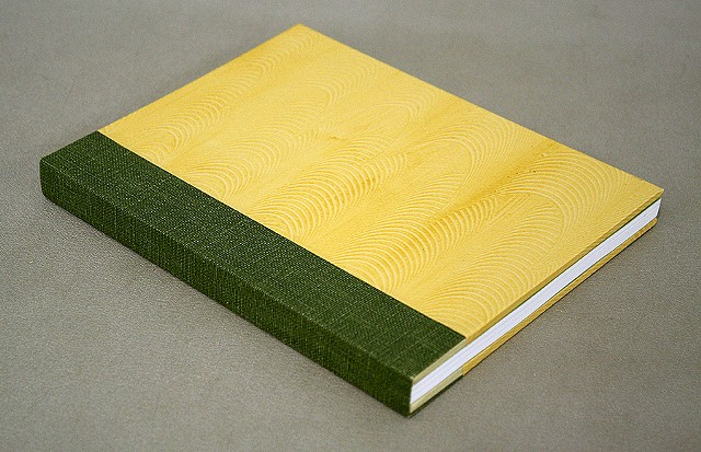 Double fan adhesive binding - yellow paste paper