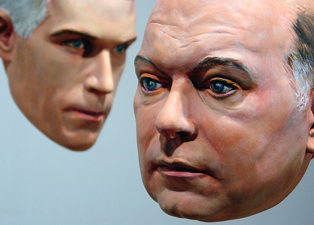sculpted painted portraits of Larry Walczak and Matthew Freedman
