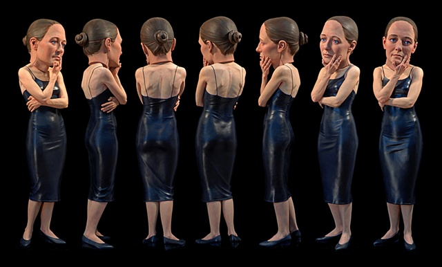 life-sized polychromed figurative sculpture of a woman in a tight dress wearing an oversized prosthetic head posed as if she is looking at something