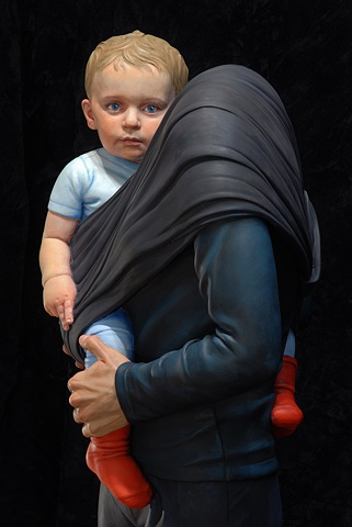 Life-size figurative sculpture of a headless woman holding a small child in a sling