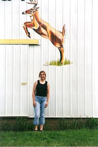 Deer painted on side of metal barn
