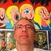 Self portrait with paintings.