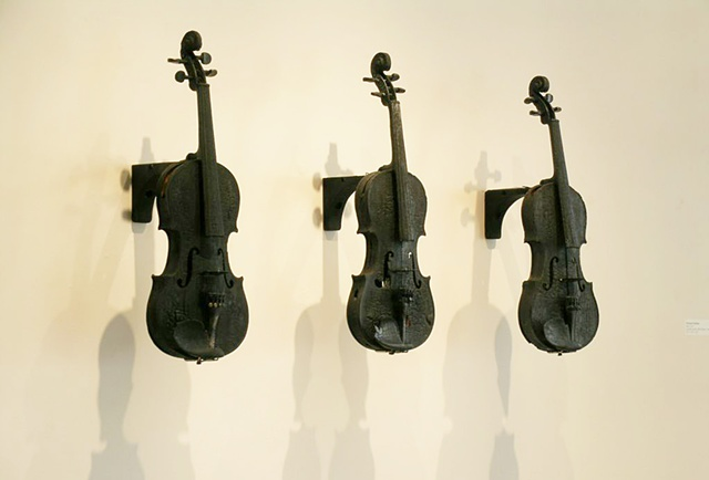 Charred violins and sound provided by Mp3 electronics