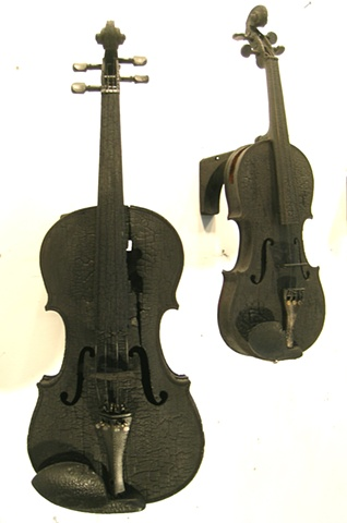 Charred violins and cellos with digital sound elements