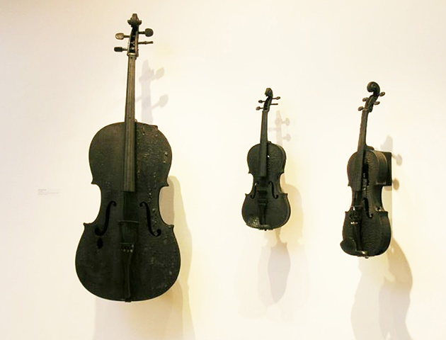 Charred violins and cellos with digital sound elements provided by Mp3 players