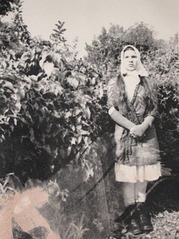 Anya's mother on their farm in Ukraine