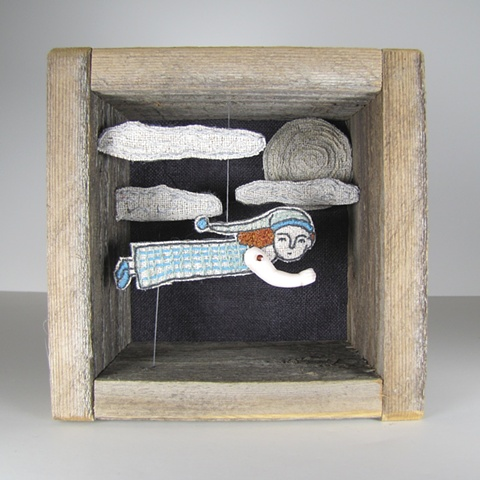 Hand embroidered diorama using antique and reclaimed materials.