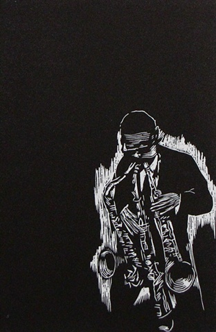 relief engraving of jazz musician roland kirk playing 3 horns