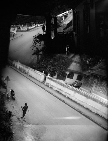 monks walking, luang prabang