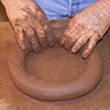 Juan Quezada adding a coil to the pot