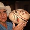 Juan Quezada holding Tan 7x10, $5200