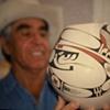 Juan Quezada holding Viboras, $5000