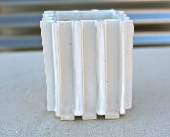 Medium extrusions, gloss white glaze.
