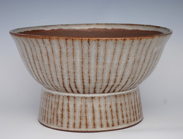 rustic modern planter-footed bowl with vertical stripes