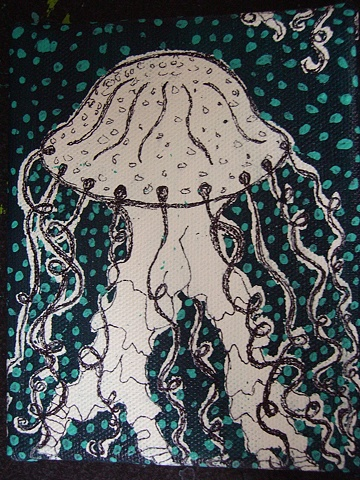 jellyfish floating through a pattern of messy dots