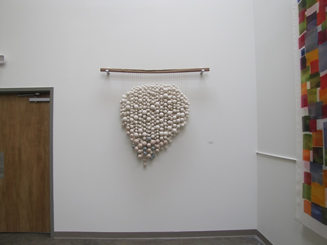 wool felt wall sculpture and walnut wood