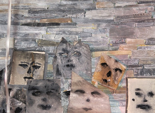 "Detail of handmade faux rock wall, and ""Suicide Masks"""