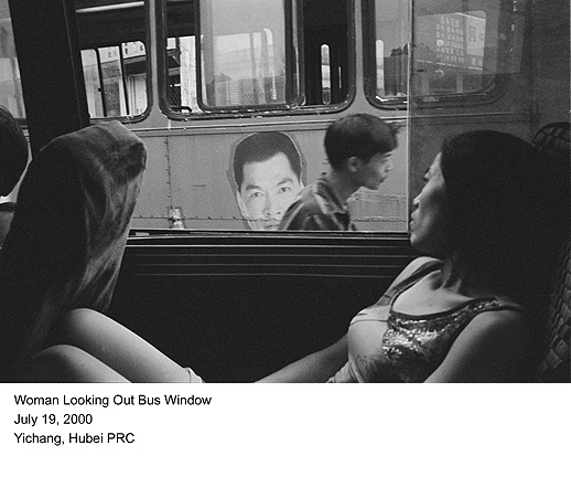 Woman Looking Out Bus Window