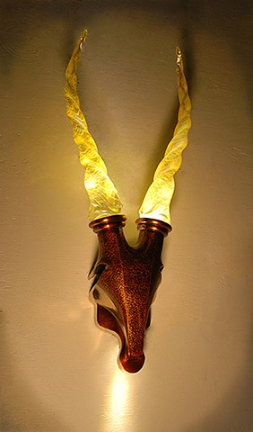 Illuminated and Illuminating Fine Art Sconce