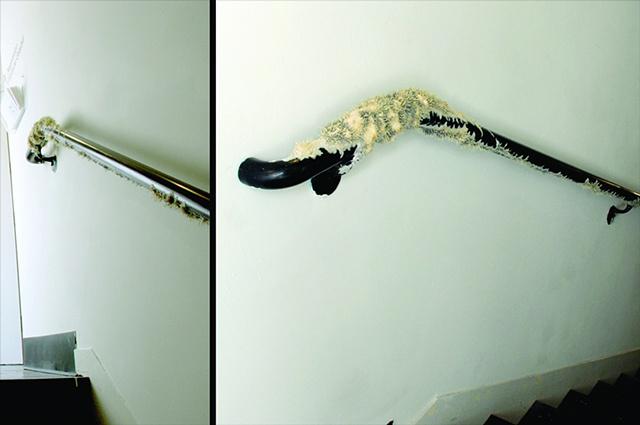 "Jasmyne Graybill Gestation Handrail, latex, flock, adhesive 108"" x 10"" diameter at largest section (Installation view)"
