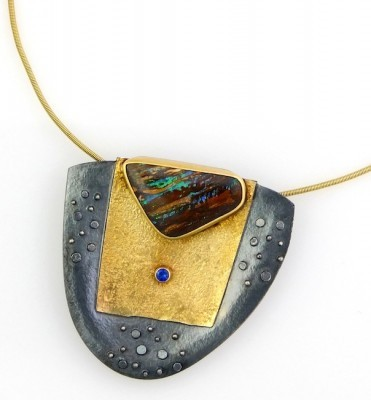 """Opal Shield Pendant"""
