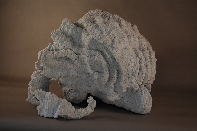 Chenille stem sculpture in the shape of a shell, inspired by the marble fountains of Rome.