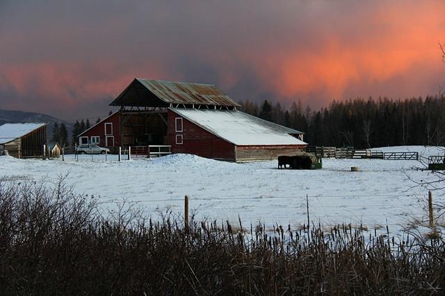 A mid-November sunset illuminates a farm near the Swan River in Montana.