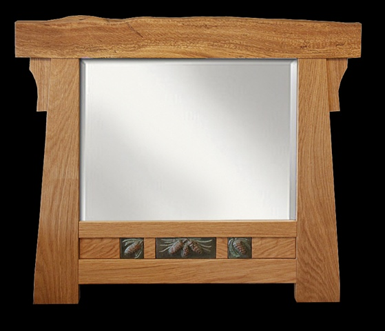 Arts & Crafts style beveled mirror with spalted oak top piece and glazed terra-cotta tiles in pine cone pattern.