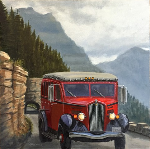 "A classic ""red jammer"" echoes the past on a cool, misty day in Glacier National Park, Montana."