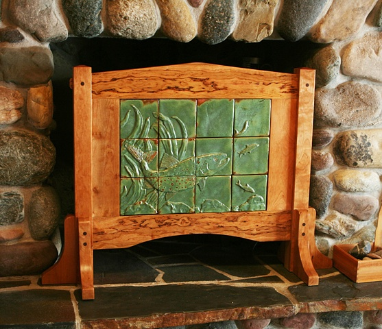 Dramatic screen built from knotty cherry with a one of a kind, hand-carved ceramic tile mural that depicts a Mackinaw (Lake Trout} in pursuit of Whitefish.