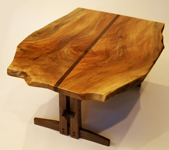 This table features a free edge sycamore top with striking grain pattern, and a contemporary black walnut base.