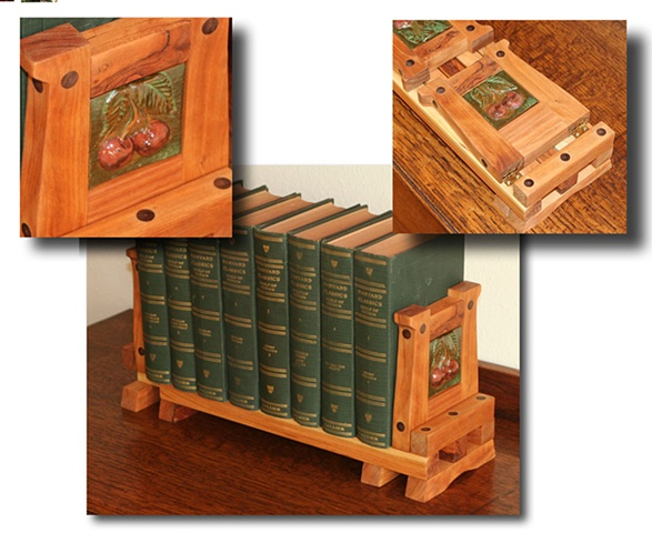 Arts & Crafts style expandable bookrack built from Knotty Cherry wood and hand-carved ceramic tiles
