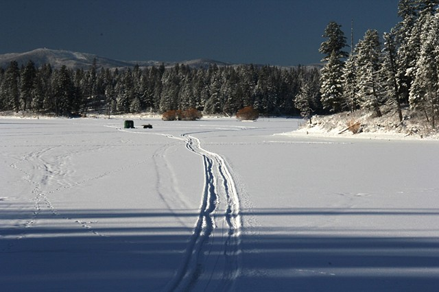 A lone ice fisherman on Echo Lake in northwestern Montana.