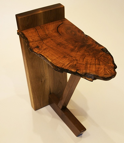 End table with free edge mesquite top and contemporary black walnut base.