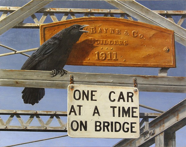 A civic minded crow helps direct traffic across the Swan River in Bigfork, Montana.