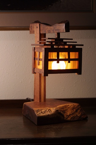 Arts & Crafts style mesquite and stained glass lamp with an Asian flair.