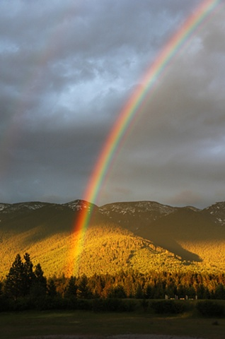 A late Spring rainbow over the Swan Mountains in northwest Montana.