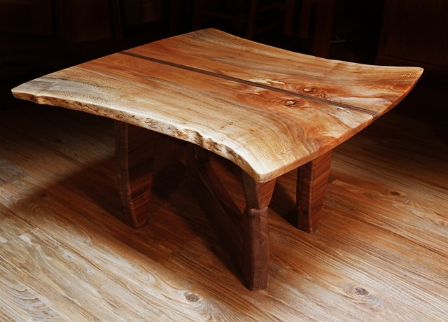 With a natural edge Sycamore top and a Black Walnut base, this table is the second in a series to honor two iconic craftsmen and designers--George Nakashima and Isamu Noguchi.