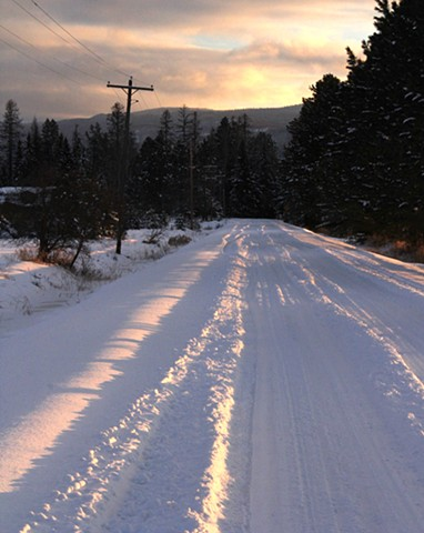 An early January dusk paints Wolf Creek Road in northwestern Montana.