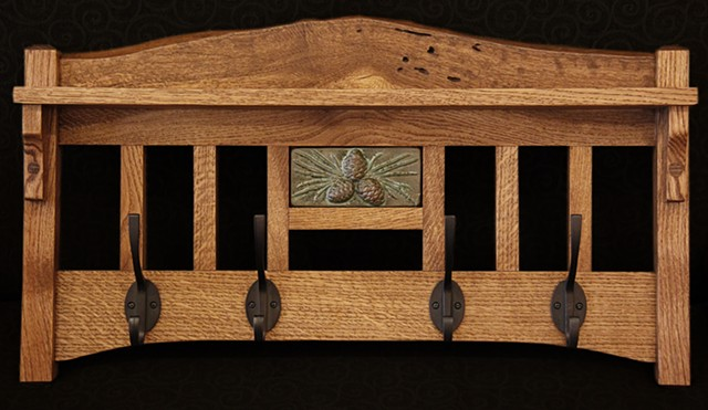 Classic craftsman style coat/hat rack in White Oak, with inset ceramic tile in pine cone pattern.